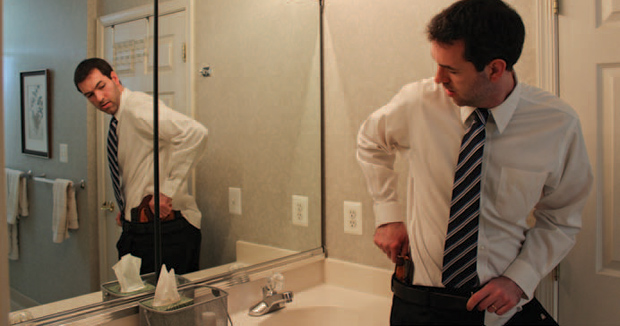 the-businessmans-guide-in-front-of-mirror