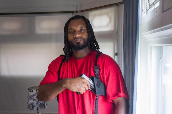 Michael Thomas with his gun at his home on the south side of Chicago, Tuesday, May 20, 2014. Michael Thomas has sued the Illinois State Police for denying his application for a concealed carry license without giving a reason why. (Alex Garcia / Chicago Tribune)